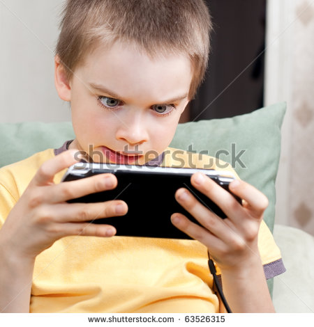 stock-photo-young-boy-playing-handheld-game-console-63526315